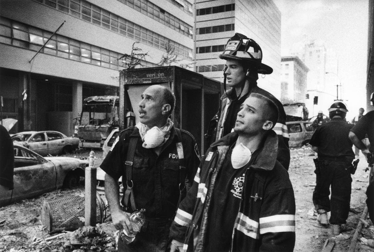 Black and white photograph of 3 NY Firemen at scene of Terrorist attack on the World Trade Center, September 11, 2001