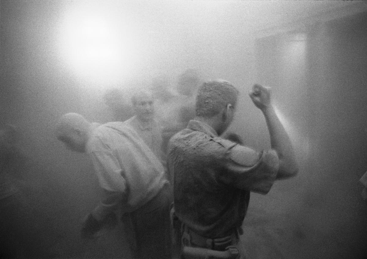Black and white photograph of survivors in dust, Wall Street, by Eric O'Connell, September 11.